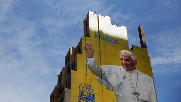 A mural of Pope Francis is viewed on the side of a building in midtown Manhattan in New York City.