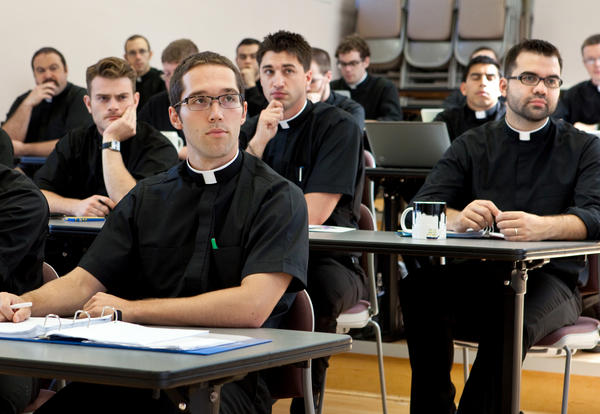 Seminarians attend a theology class at the University of Saint Mary of the Lake at Mundelein Seminary in Mundelein, Ill.