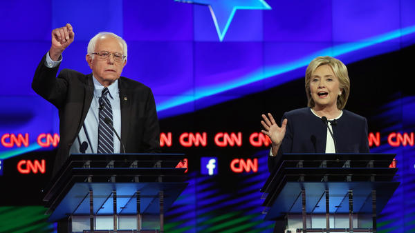 Democratic presidential candidates Bernie Sanders and Hillary Clinton on stage at the presidential debate in Las Vegas on Tuesday.