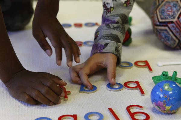 These white floor mats are one hallmark of a Montessori classroom.