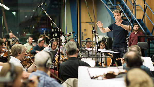 Harry Gregson-Williams leads musicians at a scoring session for <em>The Martian</em>.