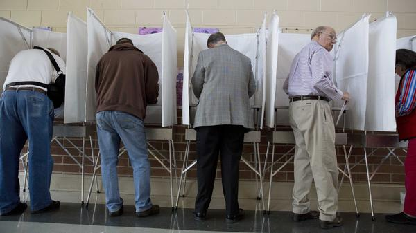 Alabama's Republican Gov. Robert Bentley (second from right) votes in 2014.