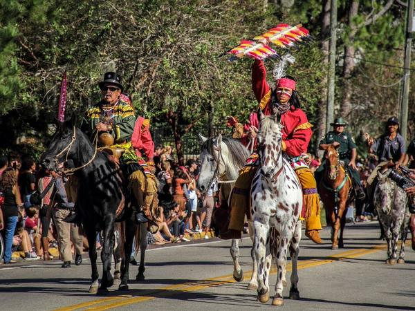 "Moses Jumper, a Seminole re-enactor from Big Cypress and ""Osceola"" lead the 2015 FSU Homecoming parade."