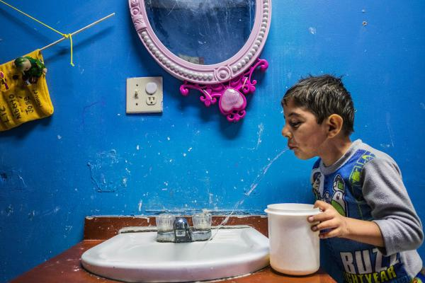 Eduardo Gonzalez is HIV positive. His mother died of AIDS; his father, who's HIV positive, is in jail. The boy lives at Eunime, a Tijuana facility for children whose parents have faced AIDS in their family and who may themselves be infected.