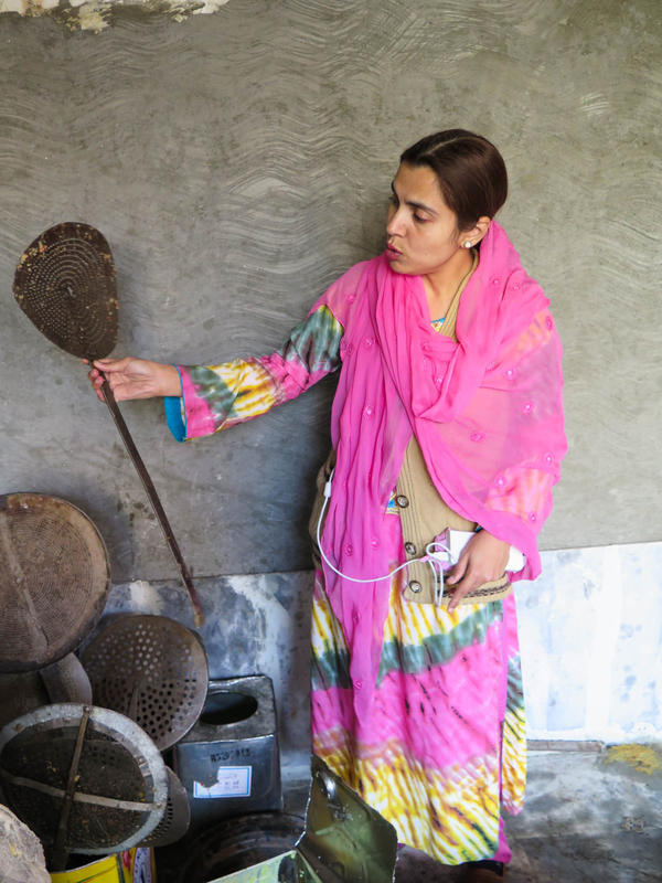 """You see the cleanliness of the utensils?"" Ayesha Mumtaz asks scathingly, as she holds up a giant spoon crusted with filth during a raid on a backyard sweets factory in Lahore, Pakistan."