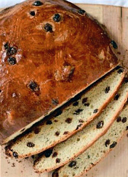 Norwegian<em> julekake </em>is made with a sweet dough, rich in eggs and sugar, and filled with candied fruit.
