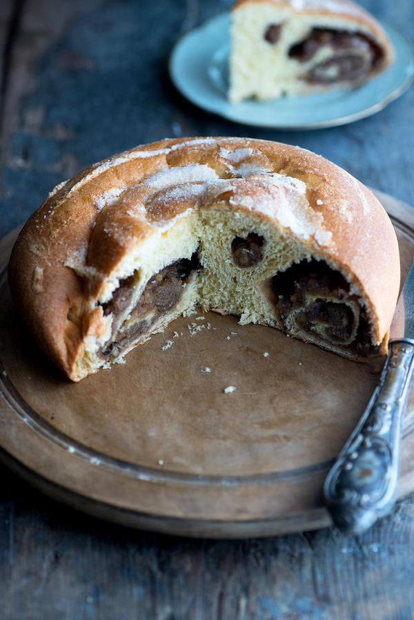 """<em>Gubana</em> is related to strudel, babka, <a href=""""http://multiculturalrecipes.blogspot.co.uk/2010/05/romania-cozonac_08.html"""" target=""""_BLANK"""">cozonac</a> and other Eastern European pastries """"stuffed"""" with filling and coiled in a pan to create an appealing spiral pattern when sliced."""