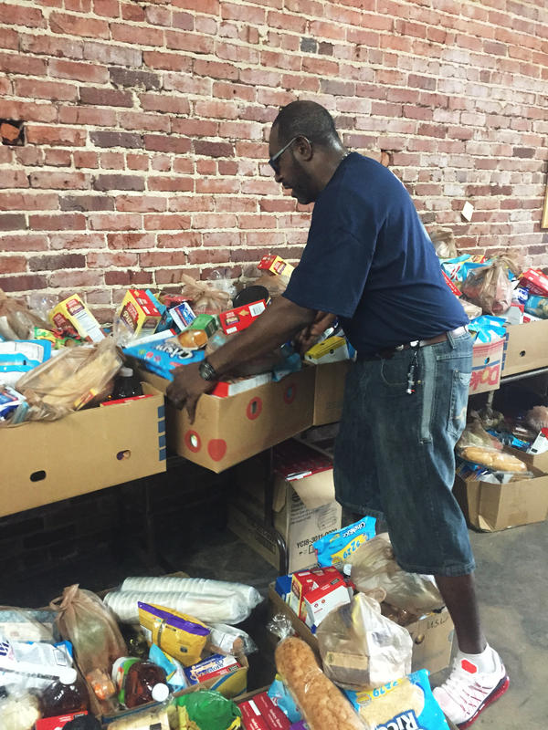 Siegfried Powell moves boxes of food at a food pantry set up by the United Steelworkers Union in Birmingham, Ala. He was laid off from his job at Fairfield Works mill after working there for 26 years.