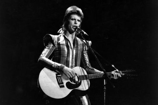 Bowie performs as Ziggy Stardust at the Hammersmith Odeon in London on July 3, 1973.