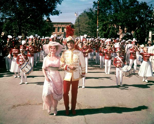 Shirley Jones and Robert Preston star in 1962's <em>The Music Man,</em> about a con man who poses as a band leader.