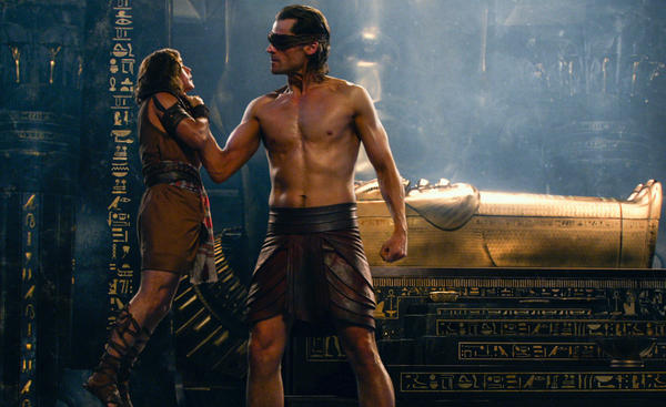 Bek (Brenton Thwaites, left) and Horus (Nikolaj Coster-Waldau) in <em>Gods of Egypt</em>.