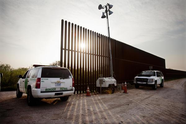 U.S. Border Patrol agents monitor a fence in Hidalgo, Texas, in 2014.
