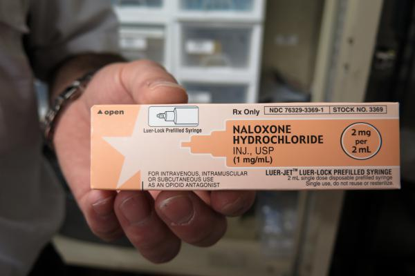 Paramedic Phil Salamone carries naloxone, a drug used to reverse an opioid overdose.