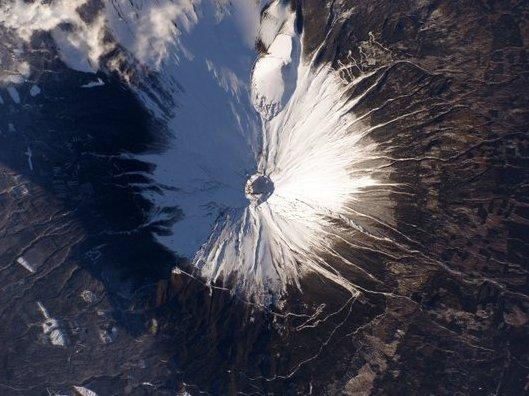 """With this shot of Mount Fuji, astronaut Scott Kelly tweeted, """"your majesty casts a wide shadow!"""""""