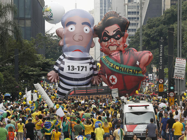 Demonstrators parade large inflatable dolls, depicting Brazil's former President Luiz Inacio Lula da Silva in prison garb and current President Dilma Rousseff dressed as a thief, in Sao Paulo on Sunday. The corruption scandal at the state-run oil giant Petrobras has ensnared key figures from Rousseff's Workers' Party, including Silva, her predecessor and mentor.
