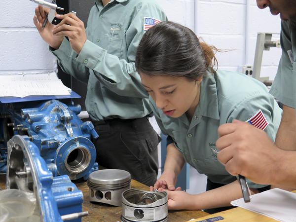 Joseline Lazo works on fixing a four-cylinder aircraft engine during class at JFK Airport.