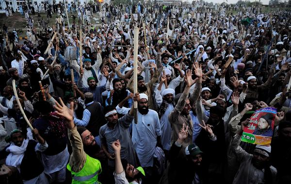 Pakistani religious protesters march in the capital Islamabad on Wednesday, where tens of thousands demonstrated this past week. Their demands included government assurances that the country's strict blasphemy laws would not be eased. The protesters agreed to leave after saying they had received such promises.