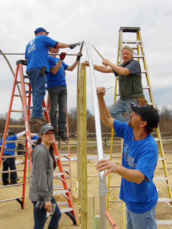 Arcadia volunteers, along with vets from the group <em>The Mission Continues</em> built a 60-foot hoop-house in one day, barn-raising style.
