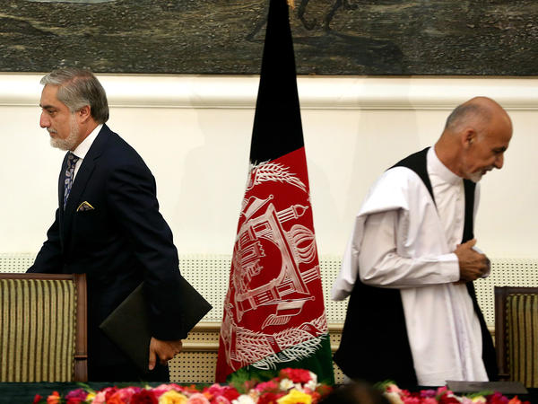 President Ashraf Ghani (right) and Chief Executive Abdullah Abdullah (left) leave after signing a power-sharing deal in September 2014 at the presidential palace in Kabul. Afghanistan's National Unity Government is now in disarray.