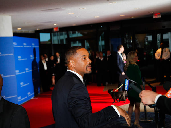 Will Smith speaking to press on the red carpet ahead of the White House Correspondents' Association Dinner on Saturday in Washington, D.C.