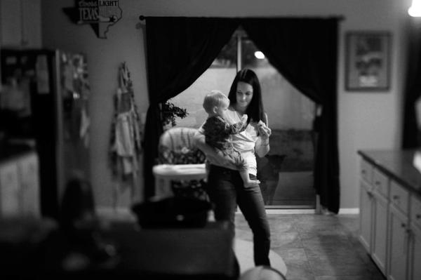 Amy Murray at home with her daughter Harper in Oceanside, Calif. Her husband, Capt. Patrick Murray, with the Darkhorse battalion, returned home from Afghanistan, in April 2011; 25 Marines from his unit did not.