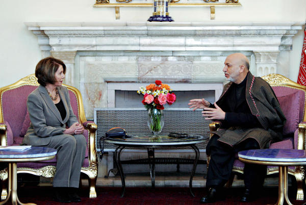 Zabihullah Tamanna was a photographer in Afghanistan for years. Here, one of his images of Afghanistan President Hamid Karzai (right) during a talk with U.S. House Speaker Nancy Pelosi at the Presidential Palace in Kabul on February 21, 2009.