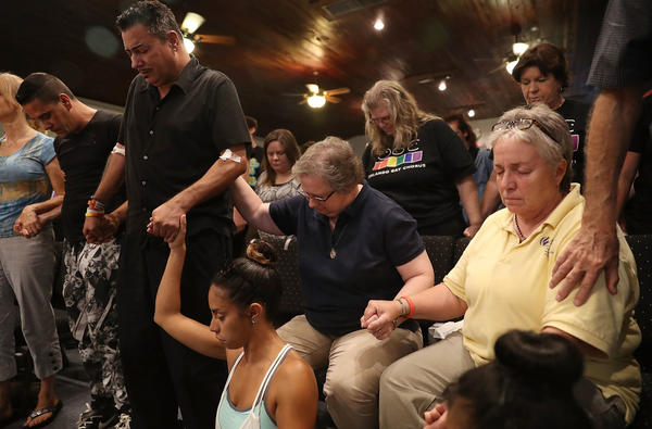 On the afternoon after a deadly attack on the Pulse Orlando nightclub, a man who says he was wounded in the violence was among those attending a memorial service at the Joy MCC Church. Officials say 49 victims died in the attack by a lone gunman who was killed in a firefight with police.