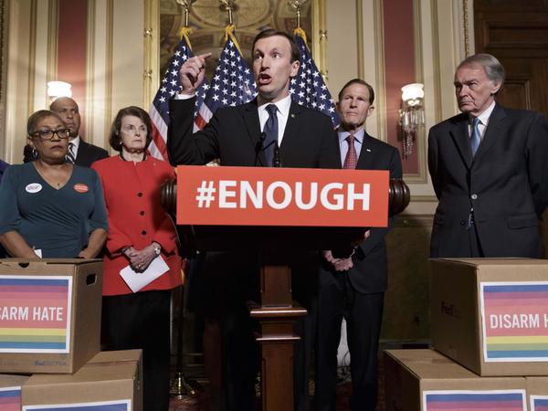 Sen. Chris Murphy, D-Conn., (center) and other Democratic senators call for gun control legislation Thursday in Washington.