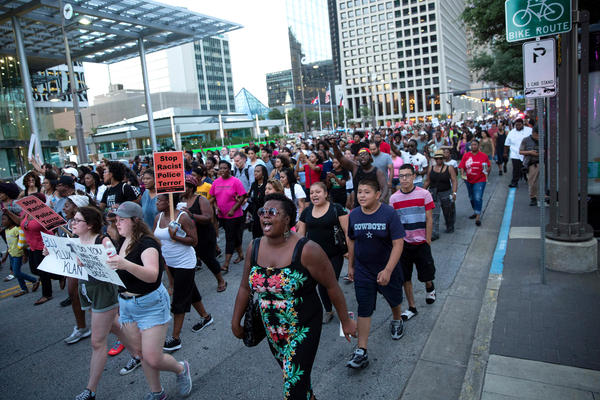 People rally in Dallas on Thursday to protest the deaths of Alton Sterling and Philando Castile.<br /><br />