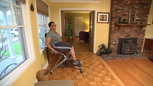 Study participant Hudson Giles Lavender burns calories on a stationary bicycle.