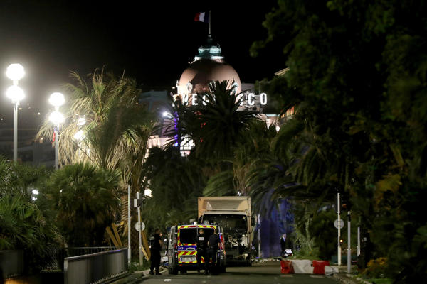 The former mayor of the French city of Nice said dozens of people were killed in the attack Thursday. He urged residents to stay indoors.