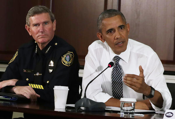 President Obama speaks as Terry Cunningham of the International Association of Chiefs of Police listens July 13 during a conversation on community policing and criminal justice at the Eisenhower Executive Office Building in Washington.
