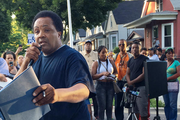 Community activist Andrew Holmes reads off the locations where youngsters have been injured unintentionally by gunfire on Chicago streets.