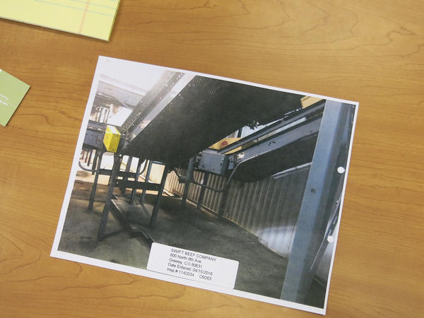 An OSHA photograph shows changes made to the conveyor belt at the JBS beef processing plant in Greeley, Colorado, that killed Ed Horner. It's now covered in a metal mesh.