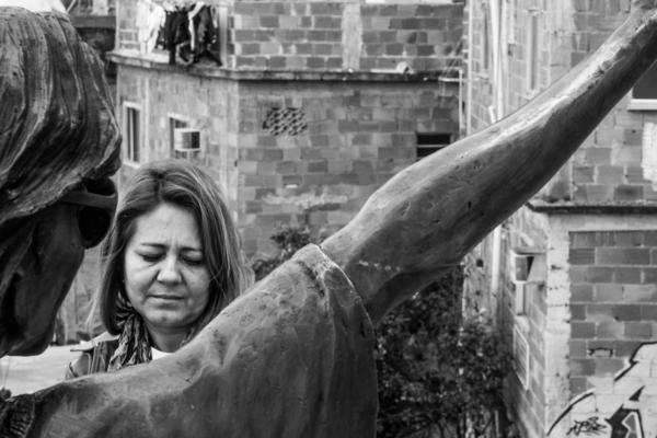 Salete Martins, a tour guide in the Santa Marta <em>favela,</em> stands in front of the Michael Jackson statue. She says tourists aren't coming because consulates told their citizens to stay away from <em>favelas.</em>