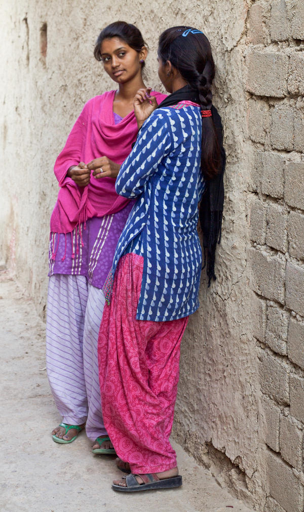 Durga (left) and her younger sister Nimmu. Last fall, we introduced Goats and Soda readers to Nimmu, married at age 10. She hadn't gone to live with her husband because she was in a boarding school to get an education. But she was struggling academically, and if she failed her next exam, she might be forced to drop out — and move in with her husband. The results are in, and Nimmu passed.