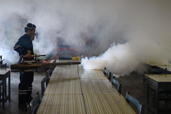 A pest control worker fumigates a school classroom in Kuala Lumpur on Sept. 4. Malaysia reported its first locally transmitted Zika case on Sept. 3.