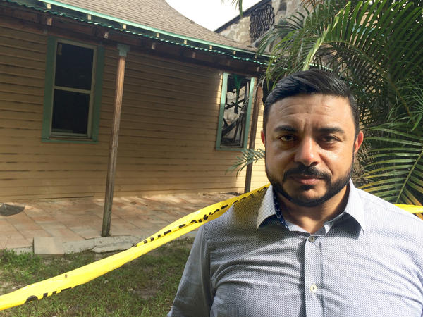 "Ahmed Bedier, a Muslim community activist, stands outside the Fort Pierce mosque, damaged in arson attack this week. He says Clinton's comments were probably ""unwise"" but ""honest."""