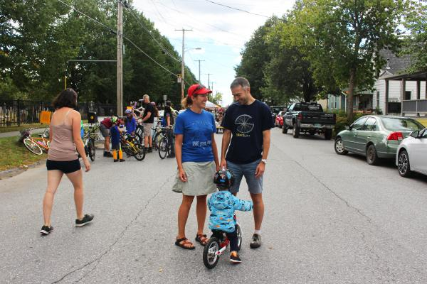 O'Neill and fellow bike lane advocate Brendan Hogan stand with Hogan's son George on a blocked off street during Open Streets in Burlington.