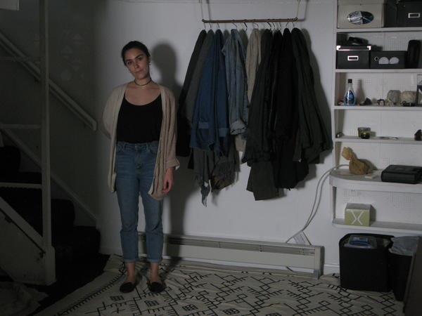 Cassandra Slack stands in the basement of her house, where she first heard the unexplained footsteps.