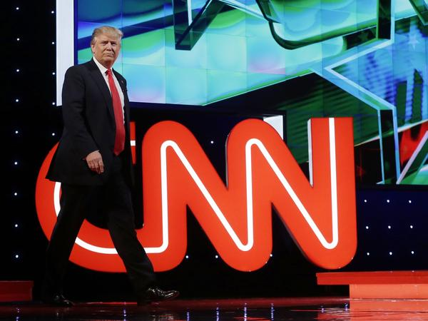 Donald Trump enters the debate hall during the Republican presidential debate co-sponsored by CNN in Coral Gables, Fla., in March. CNN is expected to see $100 million in extra revenues this year, thanks largely to its coverage of Trump.