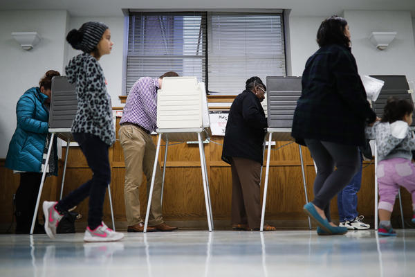 Voters fill out their ballots at the Nativity School polling place today in Cincinnati, in the bellwether state of Ohio.