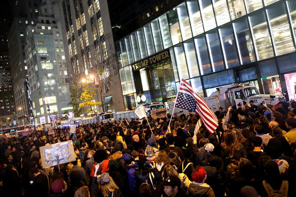 Hundreds of protestors rallying against Donald Trump gather outside of Trump Tower in New York on Wednesday evening.