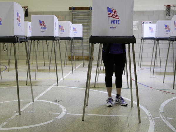 A woman casts her vote at a polling place inside Winfield Elementary School's gym in Windsor Mill, Md., during the state's 2016 primary.