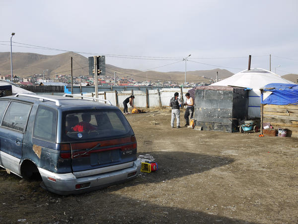 A scrapped automobile serves as a playground for the children of Gankhuyag, a former herder who lives in a ger or tent on the outskirts of Ulaanbaatar, the capital. The family moved here a few years ago when Gankhuyag started work as a porter.