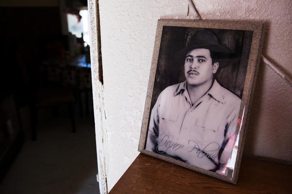A portrait of Palma's maternal grandfather, Lazaro Moreno Palma, sits on top of a shelf in the family's living room.