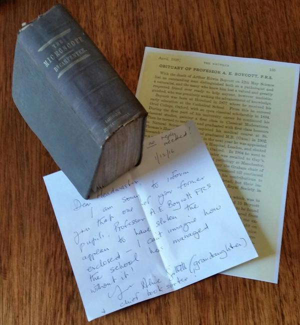 The letter from Alice Gillett, beneath the copy of <em>The Microscope and Its Revelations</em> that had been missing so long.