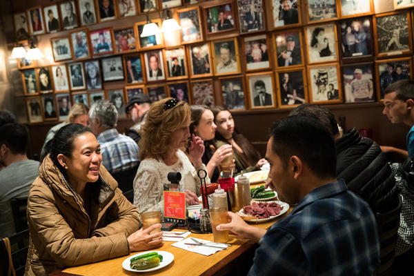 Customers dine at Carnegie Deli in New York City. The iconic deli, known for its large pastrami and corned beef sandwiches, announced it will close at the end of the year.
