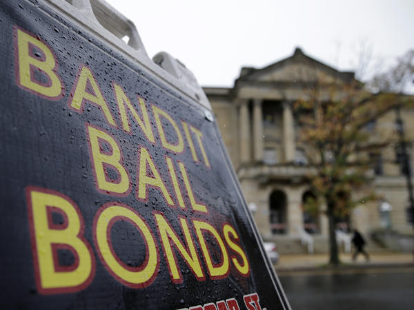 A sign is seen outside a bail bondsman across the street from Mercer County criminal courthouse on Oct. 23, 2014, in Trenton, N.J.