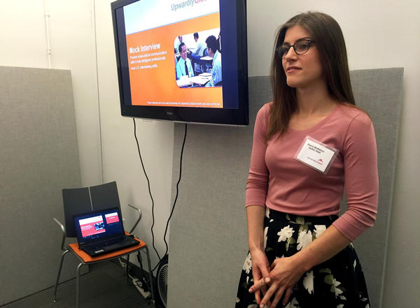 At Upwardly Global's office in New York, Alecia McMahon, a volunteer and events coordinator, introduces a workshop.